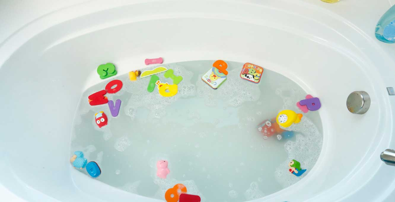 bathtub filled with toys and water